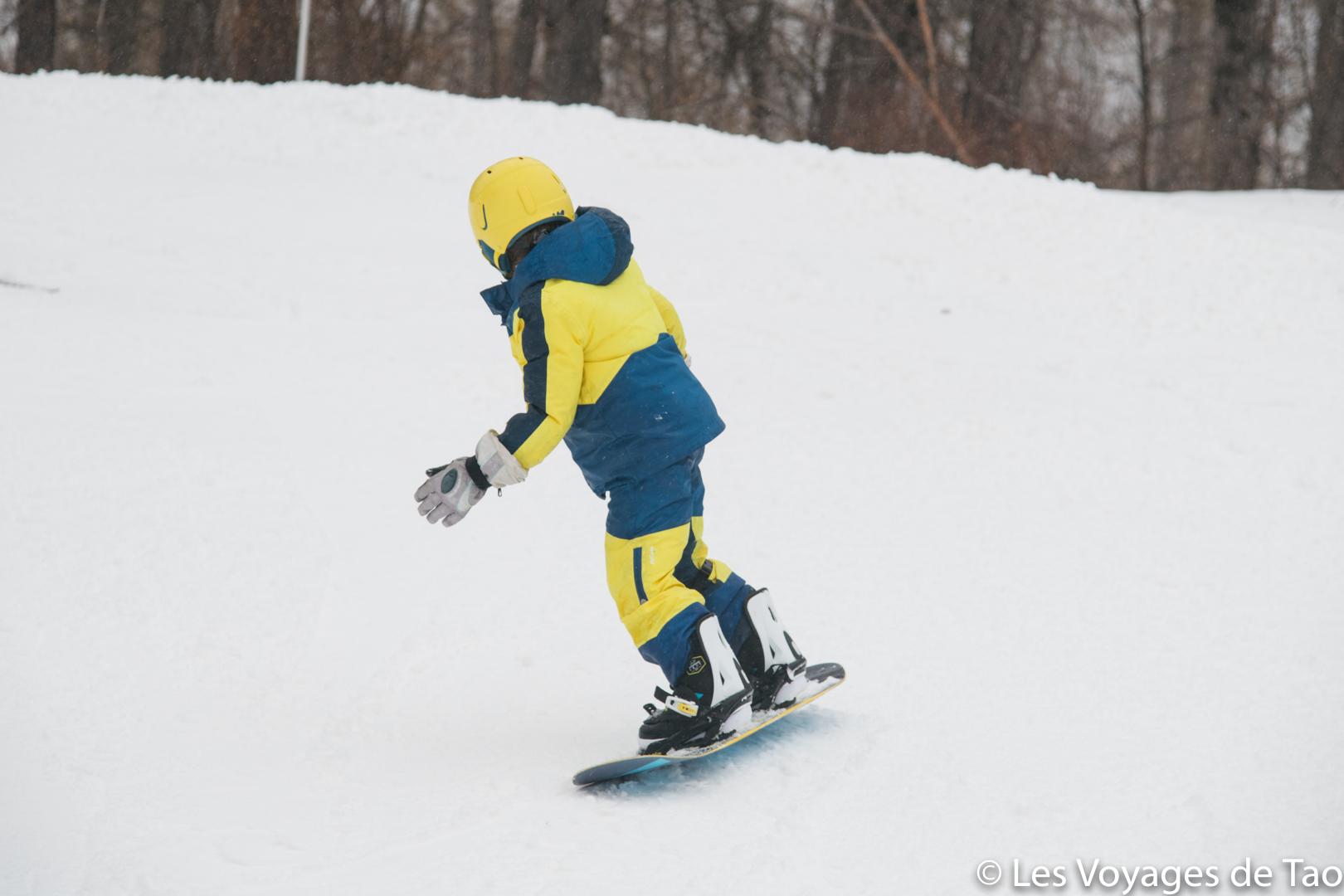 aprender snowboard para un niño
